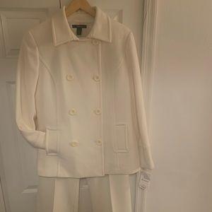 women's cream coat and slacks